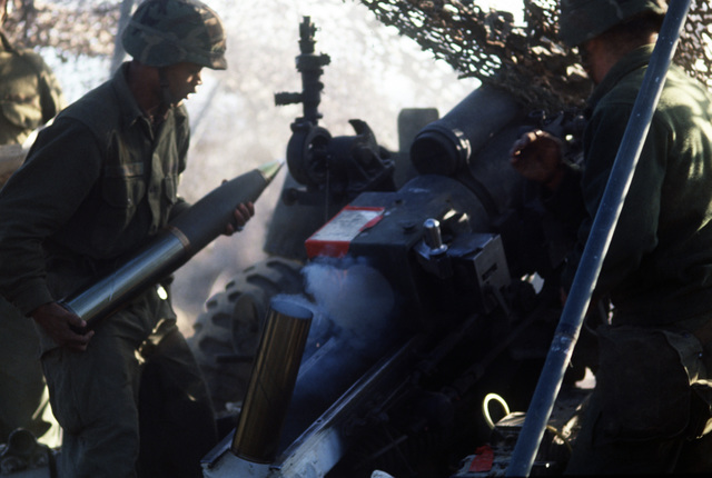 Private First Class (PFC) Richie Williams, Battery A, 4th Battalion, 11th Field Artillery, prepares to load a shell into an M101 105 mm Howitzer during the joint service combined arms live fire Exercise CALFEX III at Yukon Range
