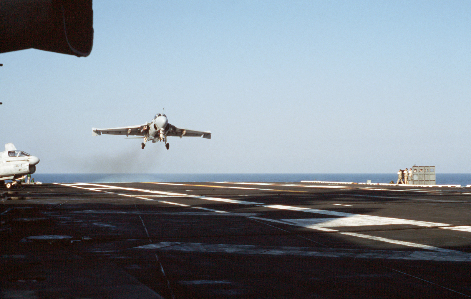 A Strike-Fighter Squadron 111 (VFA-111) A-6E Intruder aircraft approaches for a landing aboard the flight deck of the nuclear-powered aircraft carrier USS DWIGHT D. EISENHOWER (CVN 69).  Note:  First view in a series of six