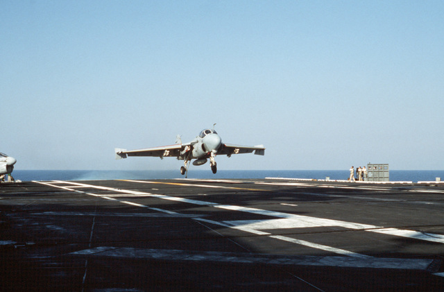 A Strike-Fighter Squadron 111 (VFA-111) A-6E Intruder aircraft approaches for a landing aboard the flight deck of the nuclear-powered aircraft carrier USS DWIGHT D. EISENHOWER (CVN 69). Note: Second view in a series of six