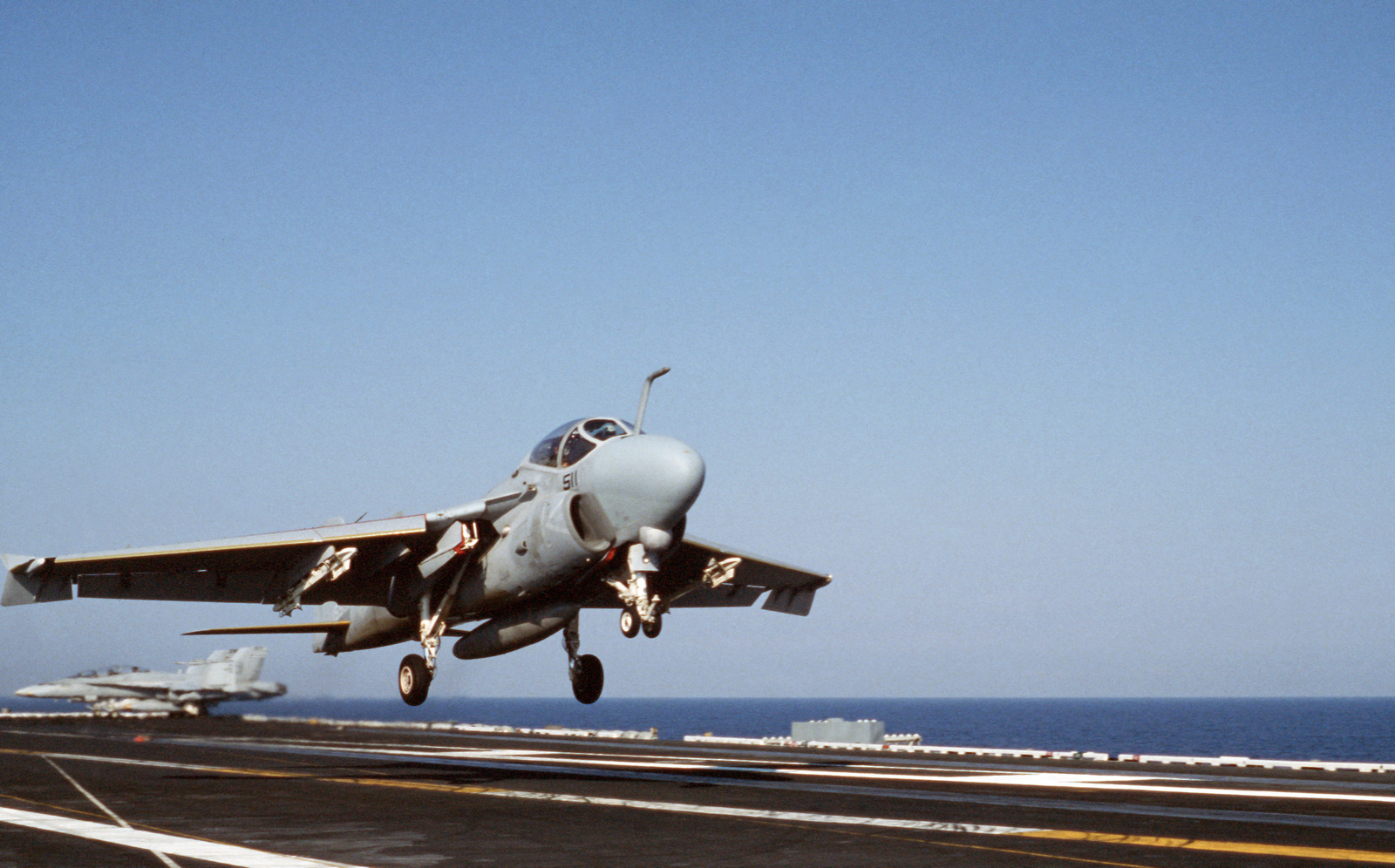 """A Strike-Fighter Squadron 111 (VFA-111) A-6E Intruder aircraft executes a """"touch and go"""" landing aboard the nuclear-powered aircraft carrier USS DWIGHT D. EISENHOWER (CVN 69)"""