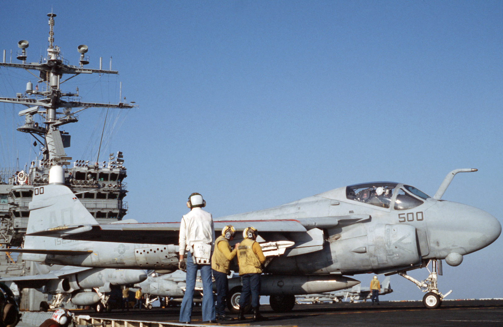 A Strike-Fighter Squadron 111 (VFA-111) A-6E Intruder aircraft is maneuvered into launching position during flight operations aboard the nuclear-powered aircraft carrier USS DWIGHT D. EISENHOWER (CVN 69)