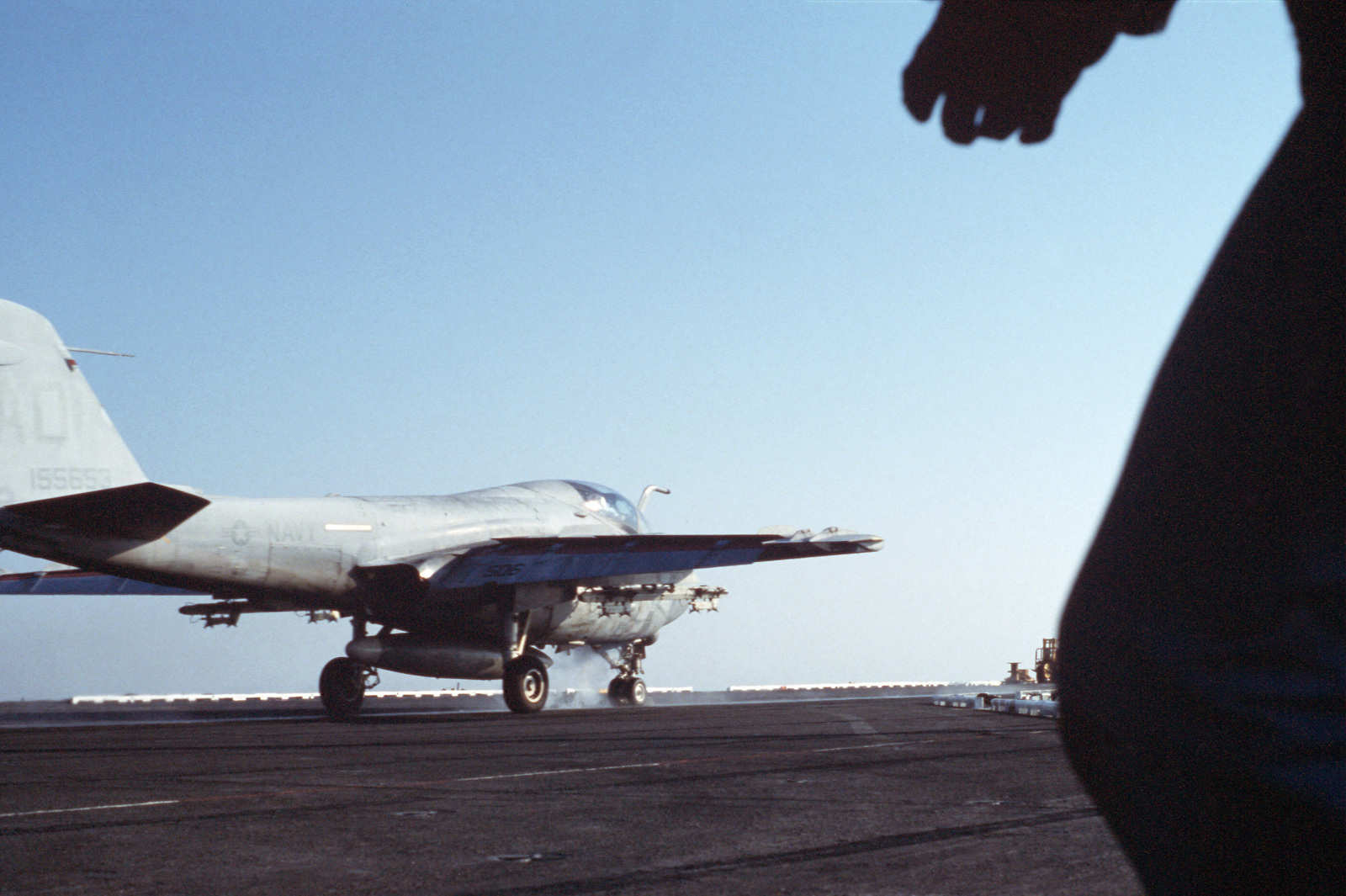 A Strike-Fighter Squadron 111 (VFA-111) A-6E Intruder aircraft lands aboard the nuclear-powered aircraft carrier USS DWIGHT D. EISENHOWER (CVN 69). Note: Fifth view in a series of six
