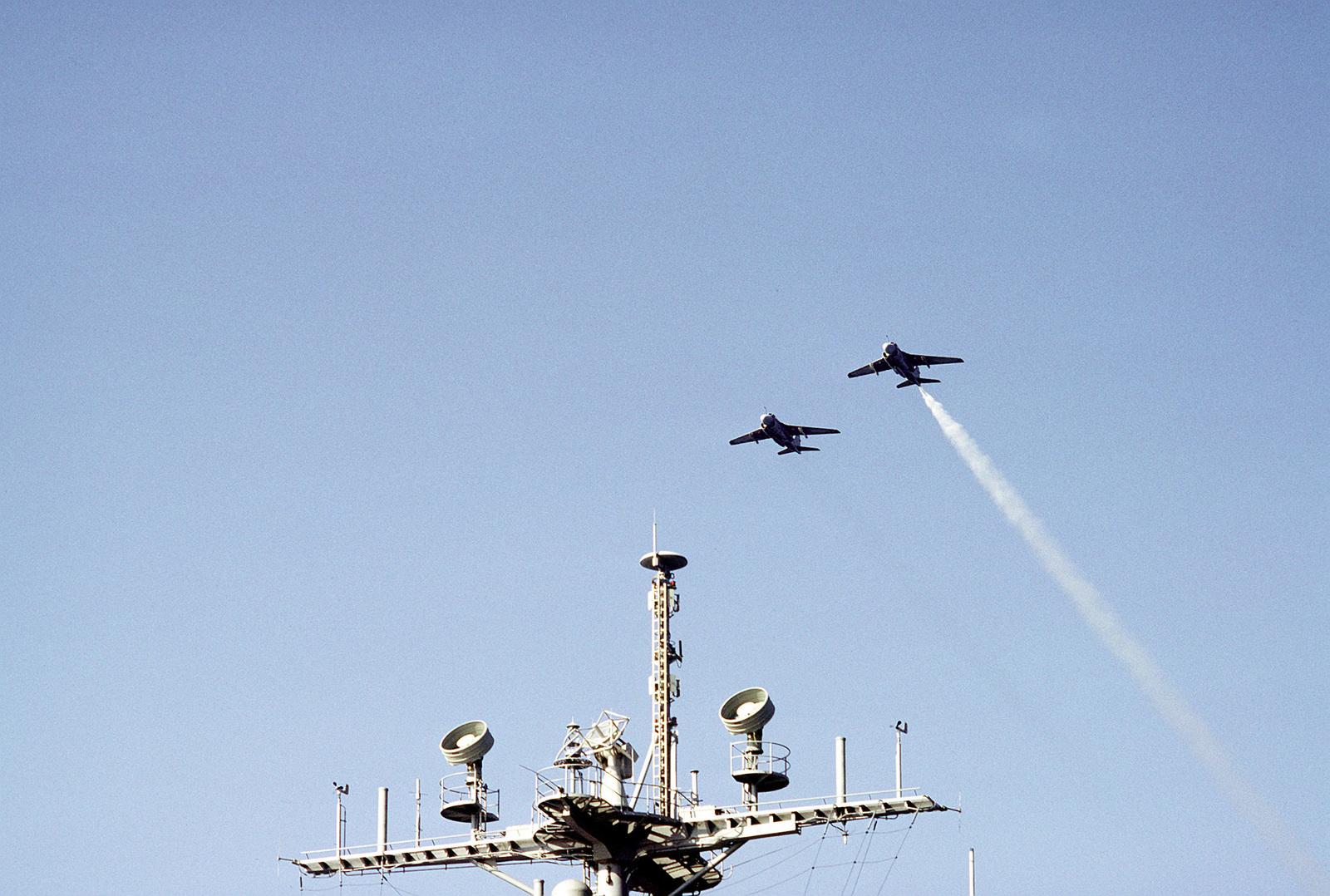 A-6E Intruder aircraft fly over the mast of the nuclear-powered aircraft carrier USS DWIGHT D. EISENHOWER (CVN-69)