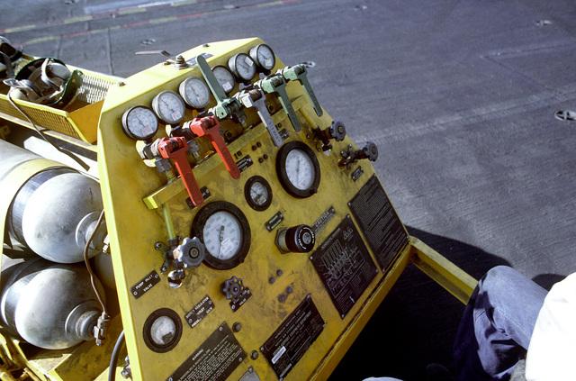A close-up view of the pressure gauges on a NAN-2 nitrogen servicing unit on the flight deck of the nuclear-powered aircraft carrier USS DWIGHT D. EISENHOWER (CVN-69)