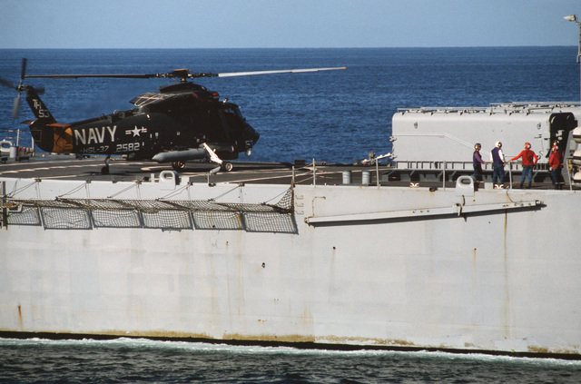 A Helicopter Light Anti-submarine Squadron 37 (HSL-37) SH-2F Sea Sprite helicopter lands on the helicopter pad of the nuclear-powered guided missile cruiser USS LONG BEACH (CGN 9).  Note:  Fourth view in a series of four