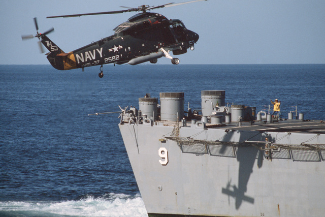 A Helicopter Light Anti-submarine Squadron 37 (HSL-37) SH-2F Sea Sprite helicopter approaches for a landing on the helicopter pad of the nuclear-powered guided missile cruiser USS LONG BEACH (CGN 9).  Note:  First view in a series of four