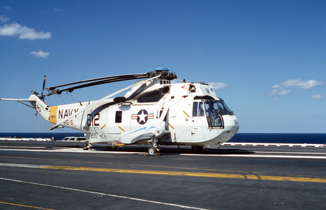 A right front view of a Helicopter Anti-submarine Squadron 5 (HS-5) SH-3H Sea King helicopter parked on the flight deck of the nuclear-powered aircraft carrier USS DWIGHT D. EISENHOWER (CVN 69)