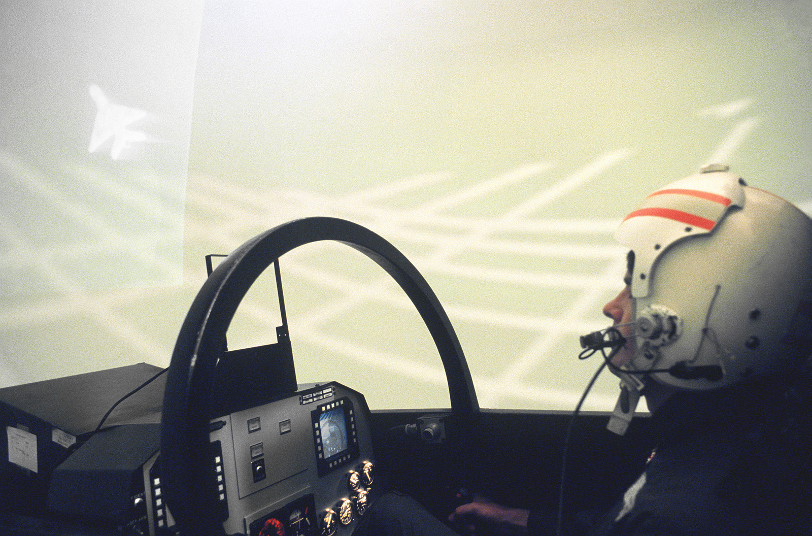 An Air Force pilot flies a simulator tracking another aircraft during a training session. Exact Date Shot Unknown