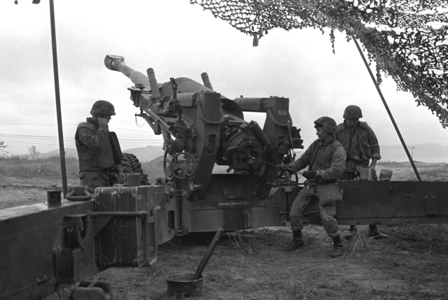 Marines of Co. L, 4th Bn., 12th Marines, fire their M-198 155mm howitzer while participating in the regimental firing exercise during Operation Bear Hunt '88