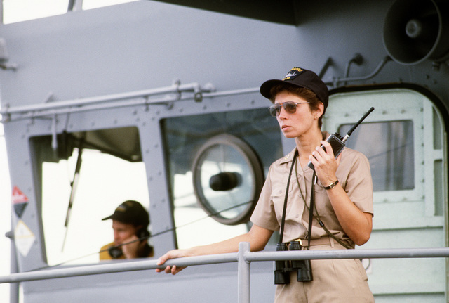 MASTER CHIEF Storekeeper Alicia Aitken, senior enlisted advisor aboard the salvage ship USS GRAPPLE (ARS-53), supervises a working party on the fantail. The Grapple is towing three minesweepers to the Persian Gulf to support U.S. Navy escort operations