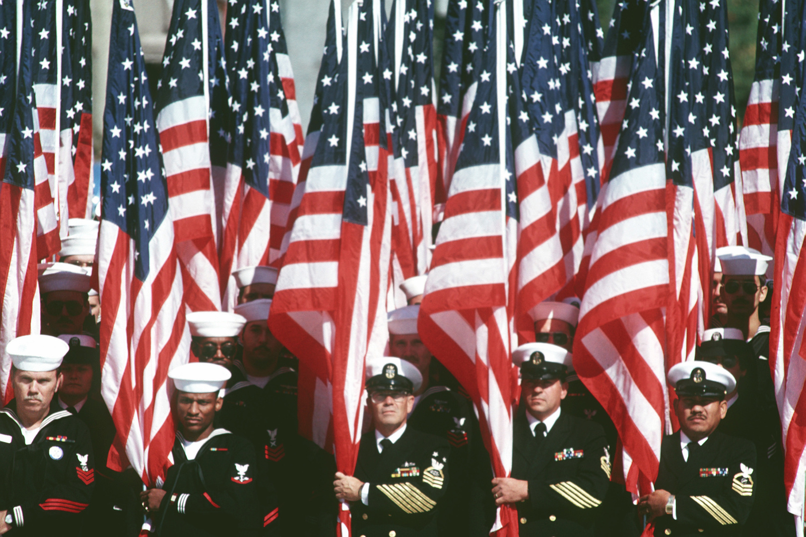 Navy men present the colors during the dedication of the Navy Memorial at 9th St. and Pennsylvania Ave