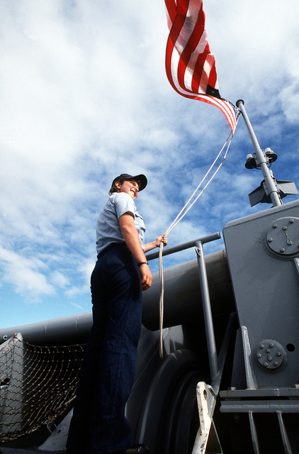 SEAMAN Patricia Volante stands by to shift the colors as the salvage ship USS GRAPPLE (ARS-53) prepares to get underway. The Grapple is towing three minesweepers to the Persian Gulf to support U.S. Navy escort operations