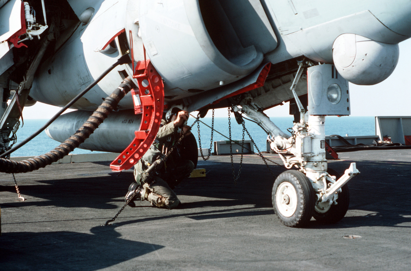 The pilot of a Strike-Fighter Squadron 111 (VFA-111) A-6E intruder aircraft performs a preflight inspection of his aircraft on the flight deck aboard the nuclear-powered aircraft carrier USS DWIGHT D. EISENHOWER (CVN 69)