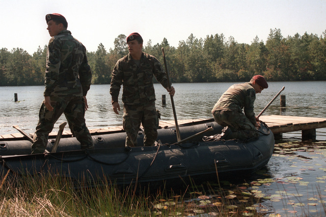 Members of the 1ST Battalion, 325th Airborne Infantry Regiment, 82nd Airborne Division, prepare amphibious assault rafts for use during a joint Air Force and Army air-drop/air-assault exercise