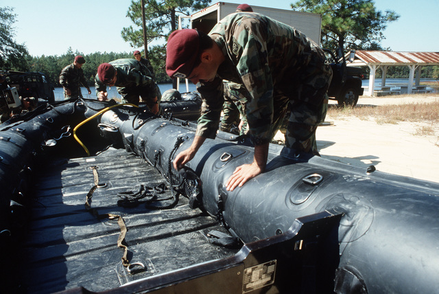 Members of the 1ST Battalion, 325th Airborne Regiment, 82nd Airborne Division, prepare amphibious assault rafts for use during a joint Air Force and Army air-drop/air-assault exercise