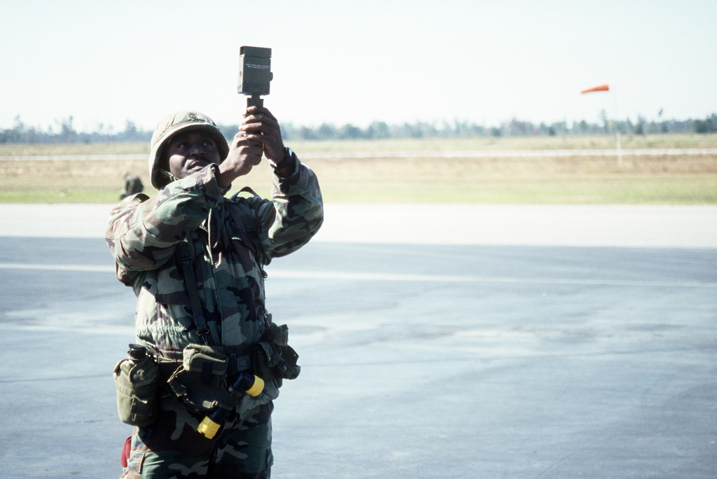 Sergeant First Class (SFC) Charles Blount, Headquarters and Headquarters Company, 325th Parachute Infantry Regiment, uses an anemometer to measure air speed to determine parachuting conditions.  Blount is participating in a joint Air Force and Army air-drop/air assault exercise