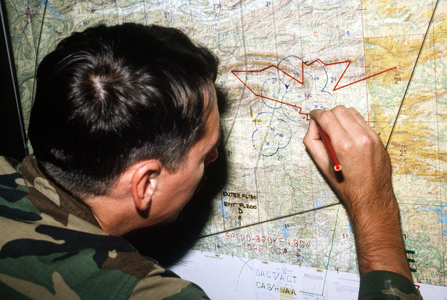 SPEC. 4 Robert Kaltz of the 3rd Battalion, 68th Air Defense Artillery, plots the course of MIM-23 Hawk missiles during a joint Air Force and Army air-drop/air-assault exercise
