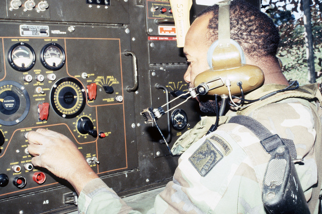 STAFF Sergeant (SSG) Larry Dickerson of Battery C, 3rd Battalion, 68th Air Defense Artillery, performs some minor adjustments on an AN/MPQ-57 radar set during a joint Air Force and Army air-drop/air-assault exercise