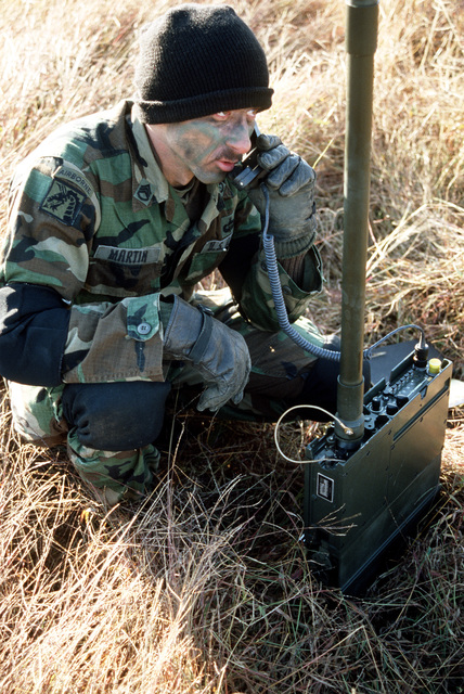 STAFF Sergeant (SSG) Rodger Martin of Company B, 1ST Battalion, 58th Aviation Regiment, sends a message on a high frequency RT 109/VRC radio during a joint Air Force and Army air-drop/air-assault exercise