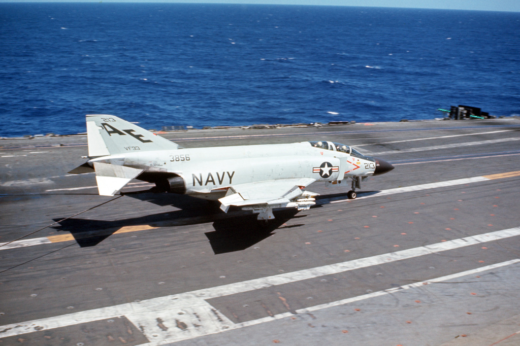 A Fighter Squadron 33 (VF-33) F-4J Phantom II aircraft lands aboard the attack aircraft carrier USS AMERICA (CVA 66)