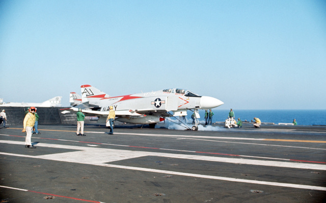 A Fighter Squadron 74 (VF-74) F-4J Phantom II aircraft is prepared for launch during flight operations aboard the attack aircraft carrier USS AMERICA (CVA 66)