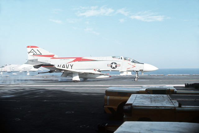 A Fighter Squadron 74 (VF-74) F-4J Phantom II aircraft lands aboard the attack aircraft carrier USS AMERICA (CVA-66)