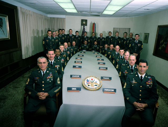 Attending the 1987 Major Command Sergeant Major's Conference at the Pentagon are, seated left to right, SGT MAJ's J. W. Gates, SMA; R. P Halpin Jr., USAREUR; W. B. Tapp Jr., AMC; G. H. Sidwell, WESTCOM; R. Voigt, USACE; R. Polk, USAISC; B. Waninger, CIDC;