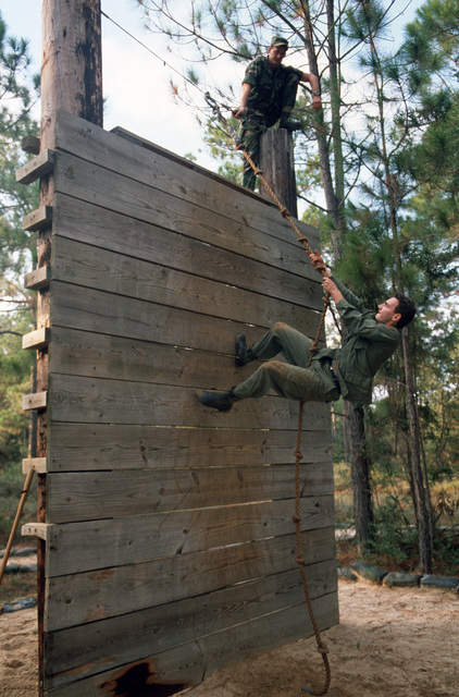 An AIRMAN attemps the rope climb while running the obstacle course at the annual Tactical Air Command Control SPECIALIST competition