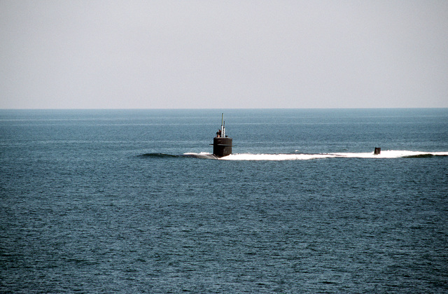 A port view of the nuclear-powered attack submarine USS NORFOLK (SSN-714) underway