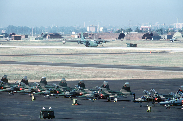 A 37th Tactical Airlift Squadron C-130 Hercules aircraft taxis near F-5A Freedom Fighter aircraft of the Turkish air force