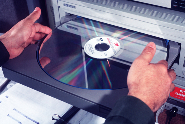 A member of the 4400th Maintenance Training Flight loads a video disc into a Sony View Interactive Videodisc System