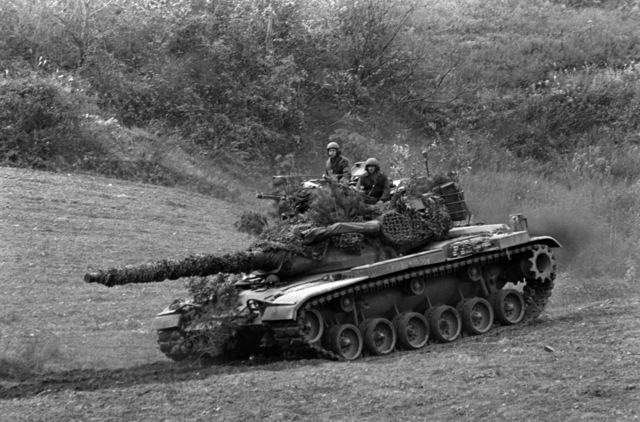 An Army M60A1 main battle tank supports the 3rd Battalion, 4th Marines, during the force-on-force exercise of Operation BEAR HUNT'88