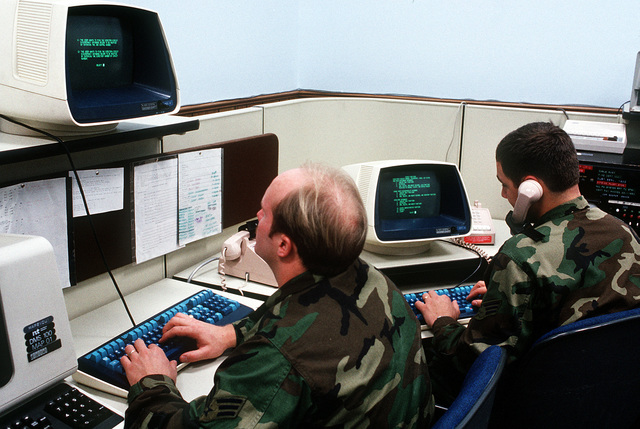 Members of the 1881st Communications Squadron man computer terminals at the Dial Central Office Management Information System (DCOMIS) Center