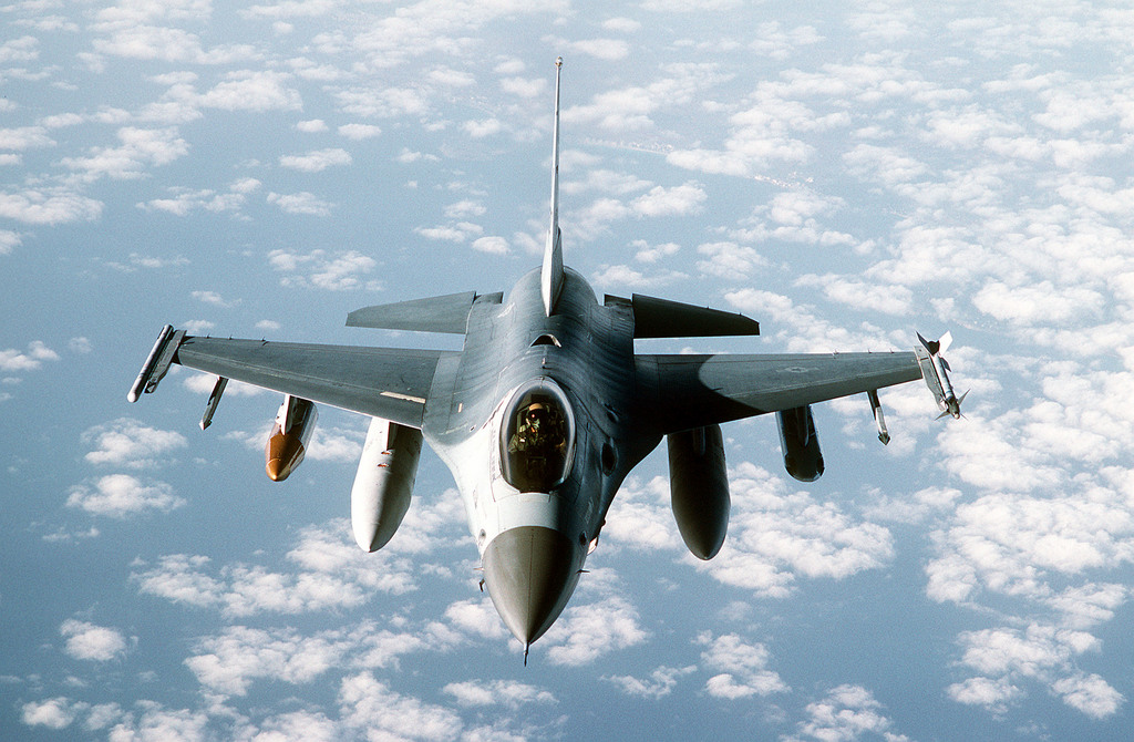 A 613th Tactical Fighter Squadron F-16A Fighting Falcon aircraft prepares to connect with a tanker aircraft as it flies over Sicily while on deployment to Incirlik Air Base, Turkey