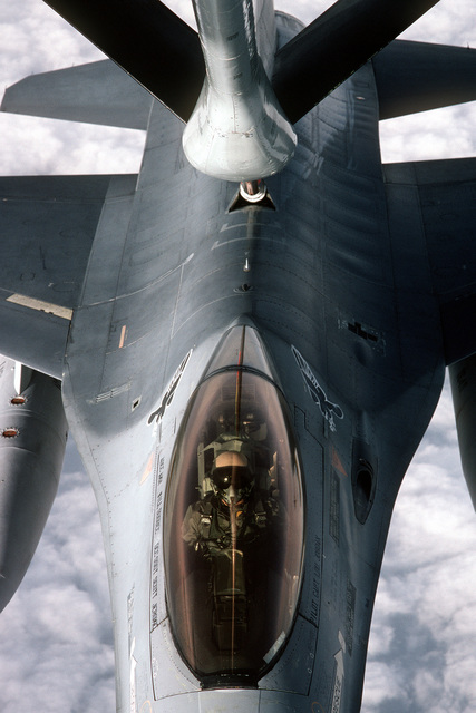 A 613th Tactical Fighter Squadron F-16A Fighting Falcon aircraft refuels from a tanker aircraft as it flies over Sicily while on deployment to Incirlik Air Base, Turkey
