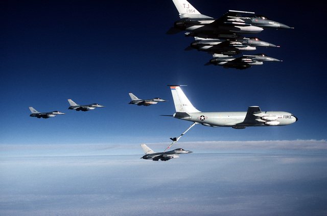 A 613th Tactical Fighter Squadron F-16A Fighting Falcon aircraft refuels from a KC-135 Stratotanker aircraft while en route to Incirlik Air Base, Turkey, on deployment. Six other F-16s await refueling