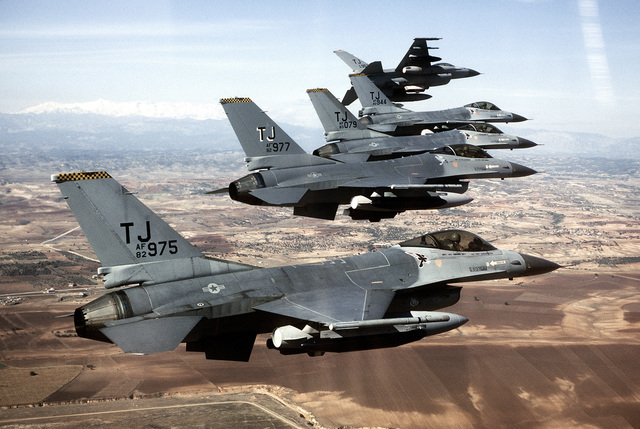An air-to-air right side view of a 613th Tactical Fighter Squadron F-16A Fighting Falcon aircraft traveling in echelon as they make their approach to land at Incirlik Air Base while on deployment
