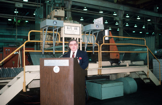 James A. Goings, director of the McDonnell-Douglas Corp. Torrance facility, speaks during the ceremonial first-cutting of metal used on the first production C-17 aircraft
