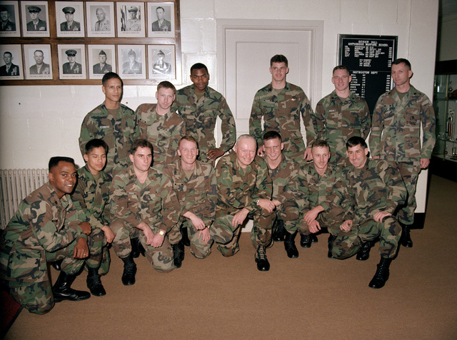 Marines of the support staff at the Amphibious Warfare School gather around General Alfred M. Gray, Commandant of the Marine Corps, for a group photograph. Kneeling in the front row are, from left: Sergeant Howard, Lance Corporal Gamboa, LCPL Sobotta, LCPL Murdock, GEN Gray, CPL Juba, CPL Lore and CPL Oliveri. In the back row are, from left: LCPL Diaz, LCPL Stephens, LCPL Wallace, STAFF Sergeant Vaccaro, SGT Hamilton and SGT Fuchs