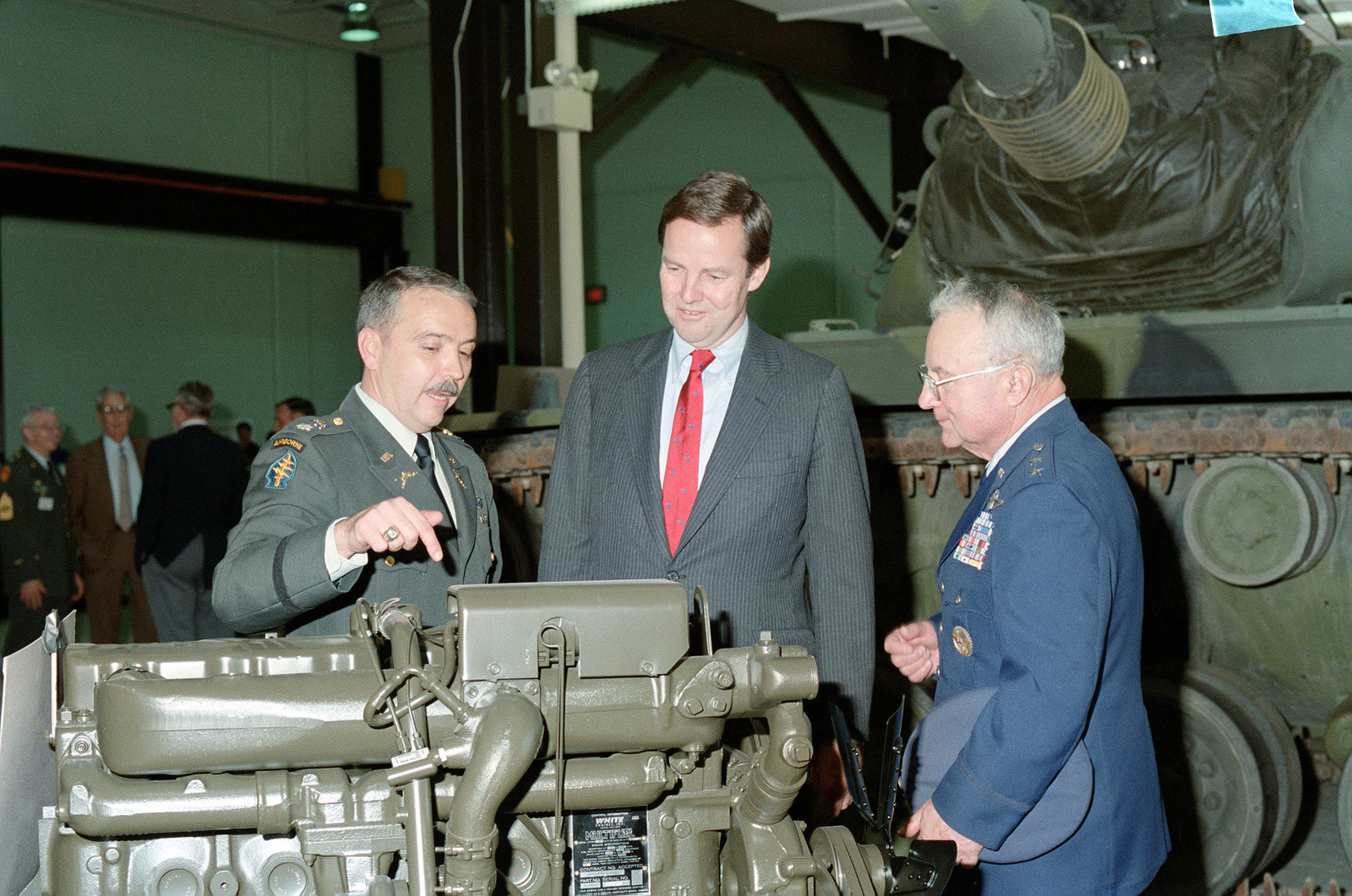 Lieutenant Colonel Harper, left, points out a feature of a multifuel truck engine while talking to New Jersey Governor Thomas H. Kean, center, and Major General Francis R. Gerard, State Adjutant General, New Jersey National Guard, during the opening of the New Jersey National Guard High Technology Training Center