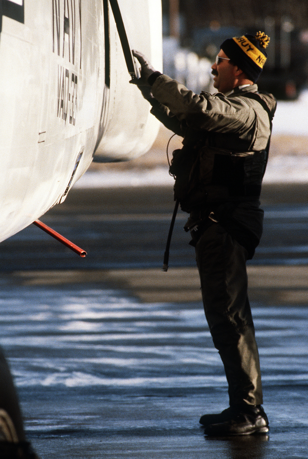 A crewman inspects an A-3 Skywarrior aircraft prior to a mission