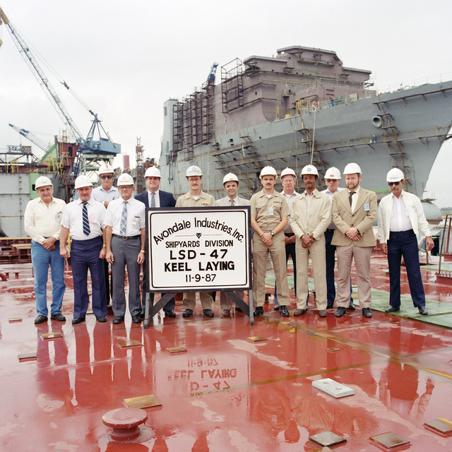 Attending the keel laying for the dock landing ship USS RUSHMORE (LSD 47) are, from left to right: Emile Foret, Avondale Industries, Inc. (AAI); James Schiro (AAI); Lawrence Torres (AAI); Julius Laurent (AAI); Eric Houin (AAI); Commander (CDR) Jim Mullican, office of the supervisor of shipbuilding, New Orleans (SSNO); Chris Sprague (AAI); Lieutenant Commander (LCDR) Frank Forkel (SSNO); Dewey Lee (SSNO); Norman Nowell (SSNO); C.C. Cole (SSNO); Charles Turberville (SSNO); and Donald Cazaubon (SSNO)