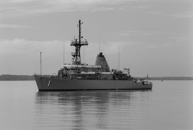 A port bow view of the mine countermeasures ship USS AVENGER (MCM 1) arriving in home port at Naval Base, Charleston. The AVENGER assigned to Mine Squadron 2, is the first of eight ships currently being built by the Navy to replace the older ocean minesweepers (MSOs) constructed in the 1950s