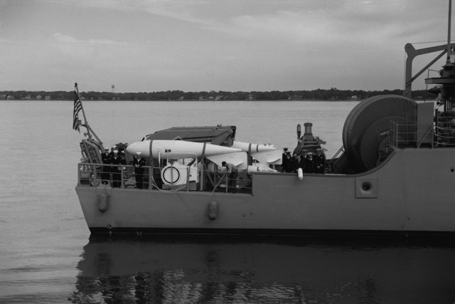 A view of the stern of the mine countermeasures ship USS AVENGER (MCM 1) arriving in home port at Naval Base, Charleston. The AVENGER assigned to Mine Squadron 2, is the first of eight ships currently being built by the Navy to replace the older ocean minesweepers (MSOs) constructed in the 1950s