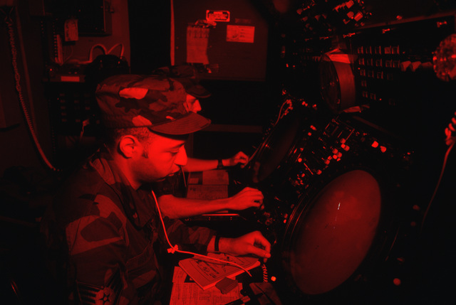 STAFF Sergeant (SSGT) Othello Bland, front, and AIRMAN First Class (A1C) Shawn E. Ott track aircraft on a monitor screen inside a radar van during Exercise CORONET STROKE'88.  The objectives of the exercise are to establish and maintain a netted tactical air control system, set up a composite air surveillance system, and control sorties flown by various aircraft to test their combat capabilities under difficult field conditions.  CORONET STROKE'88 represents the largest single-service netting of tactical communication in Air Force history
