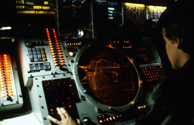 Weapons controller First Lieutenant (1LT) Michelle J. Pool, 726th Tactical Control Squadron, works an OJ-108 radar scope during Exercise CORONET STROKE'88.  The objectives of the exercise are to establish and maintain a netted tactical air control system, set up a composite air surveillance system, and control sorties flown by various aircraft to test their combat capabilities under difficult field conditions.  CORONET STROKE'88 represents the largest single-service netting of tactical communication in Air Force history