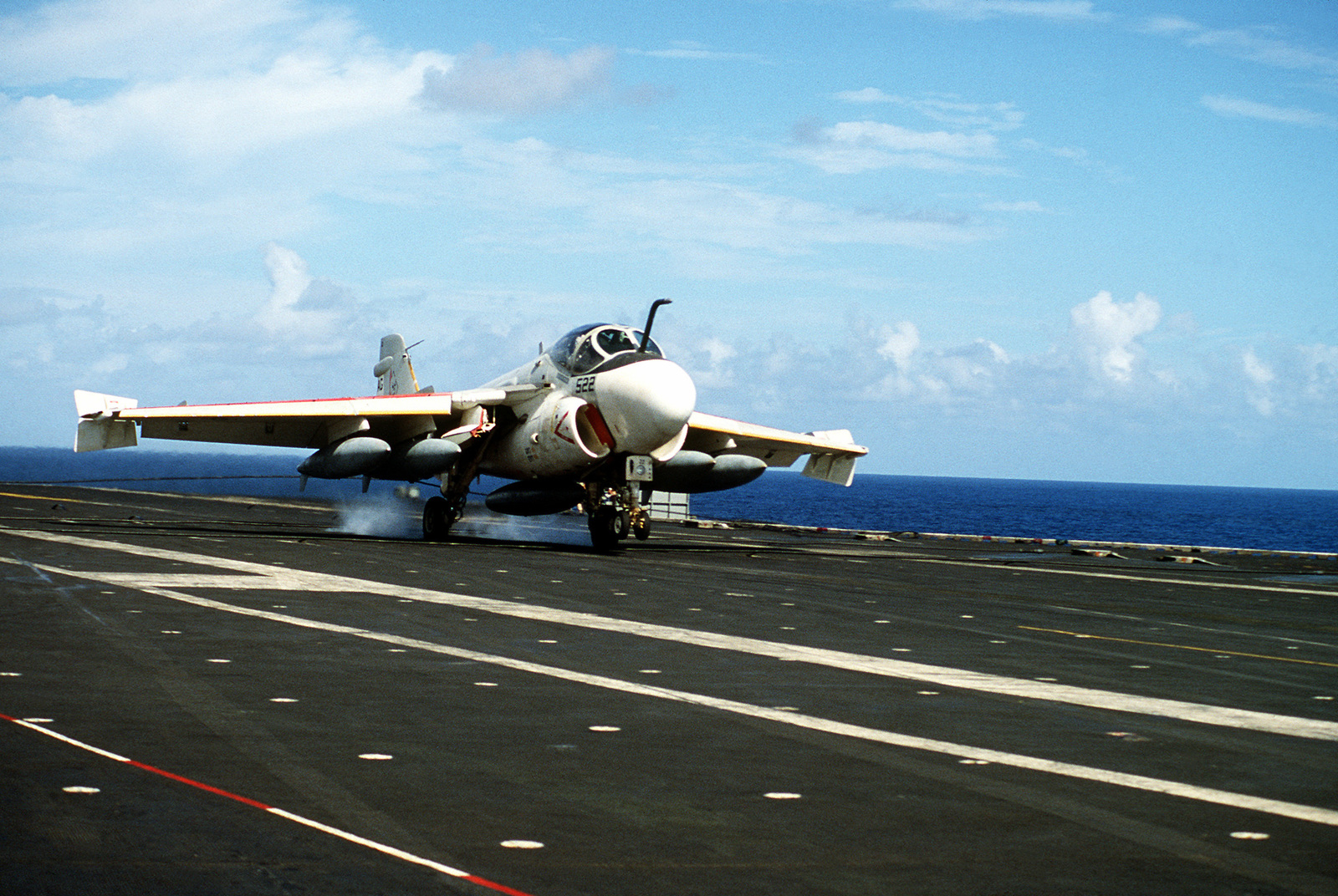 An A-6 Intruder aircraft engages an arresting cable after landing aboard the aircraft carrier USS SARATOGA (CV60)