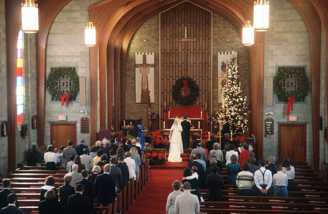 Catholic Chaplain (CMDR.) Roabert Kincl performs a marriage in the Chapel of the Good Shepherd