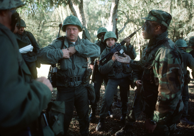 Construction Mechanic 2nd Class (CM2) Eric Cambell instructs members of Naval Mobile Construction Battalion 4 on patrol and ambush techniques during the battalion's annual 20-day combat field exercise