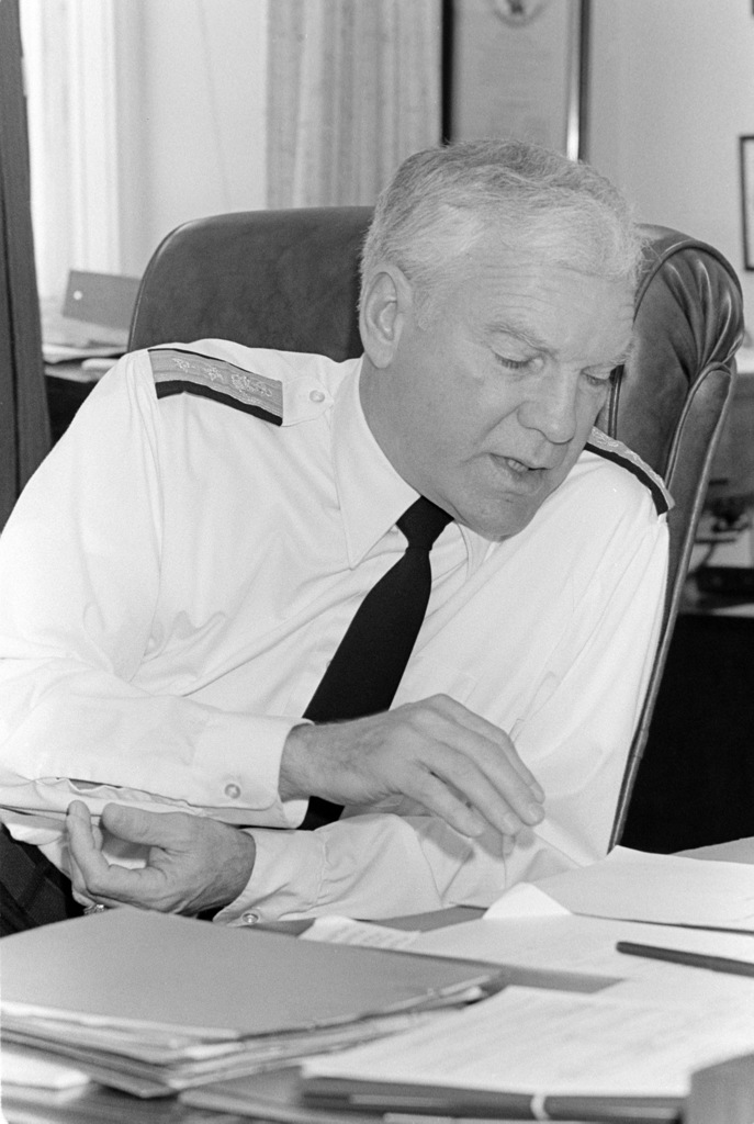 Rear Admiral (RADM) (upper half) F. Neale Smith, USNR, chief of naval reserve, in his office at the Pentagon